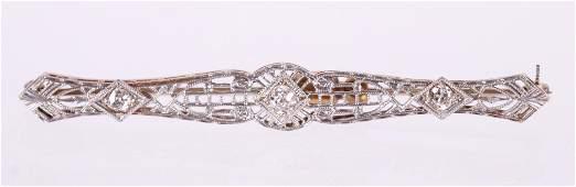 A 14K Gold and Diamond Pin