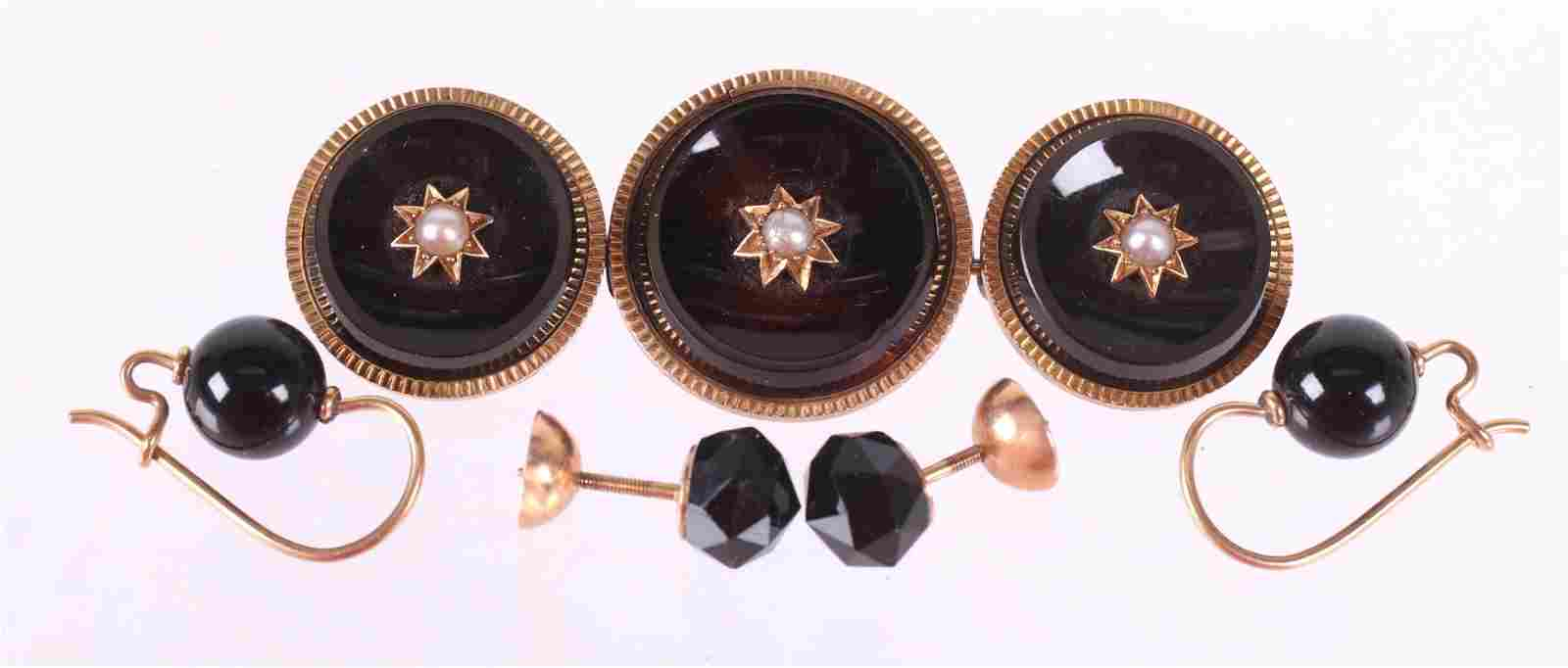 A Group of Victorian Gold and Onyx Mourning Jewelry