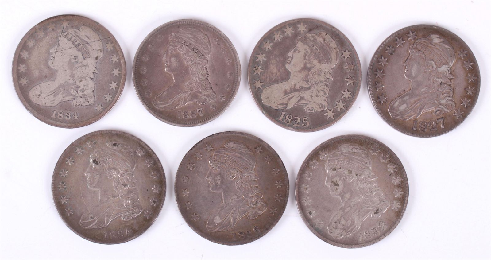 Seven US Silver Coins: Capped Bust Half Dollars