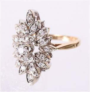A 14k Gold and Diamond Ring