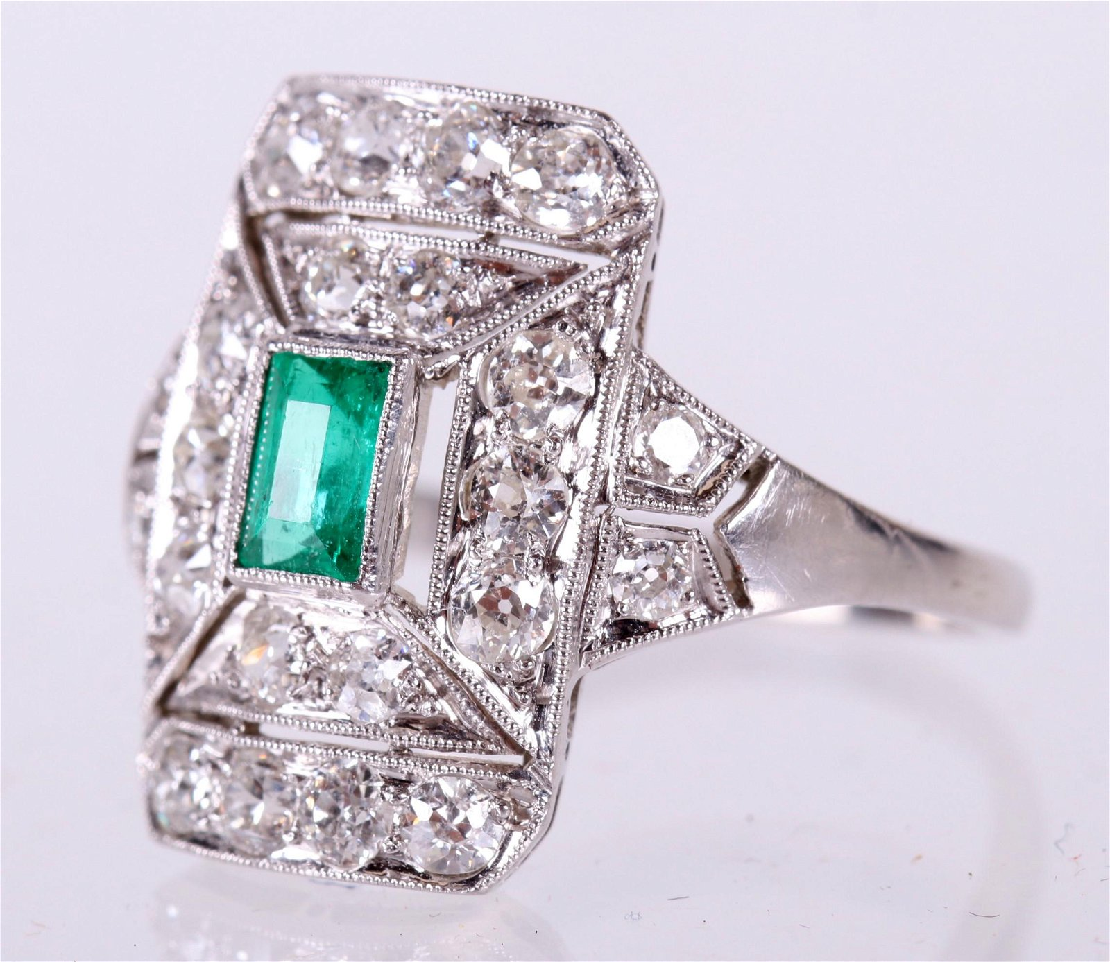 A Platinum, Diamond and Emerald Ring