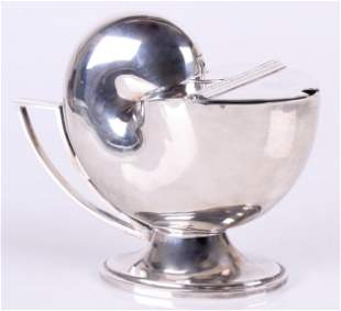 A Silver Plate Nautilus Form Spoon Warmer