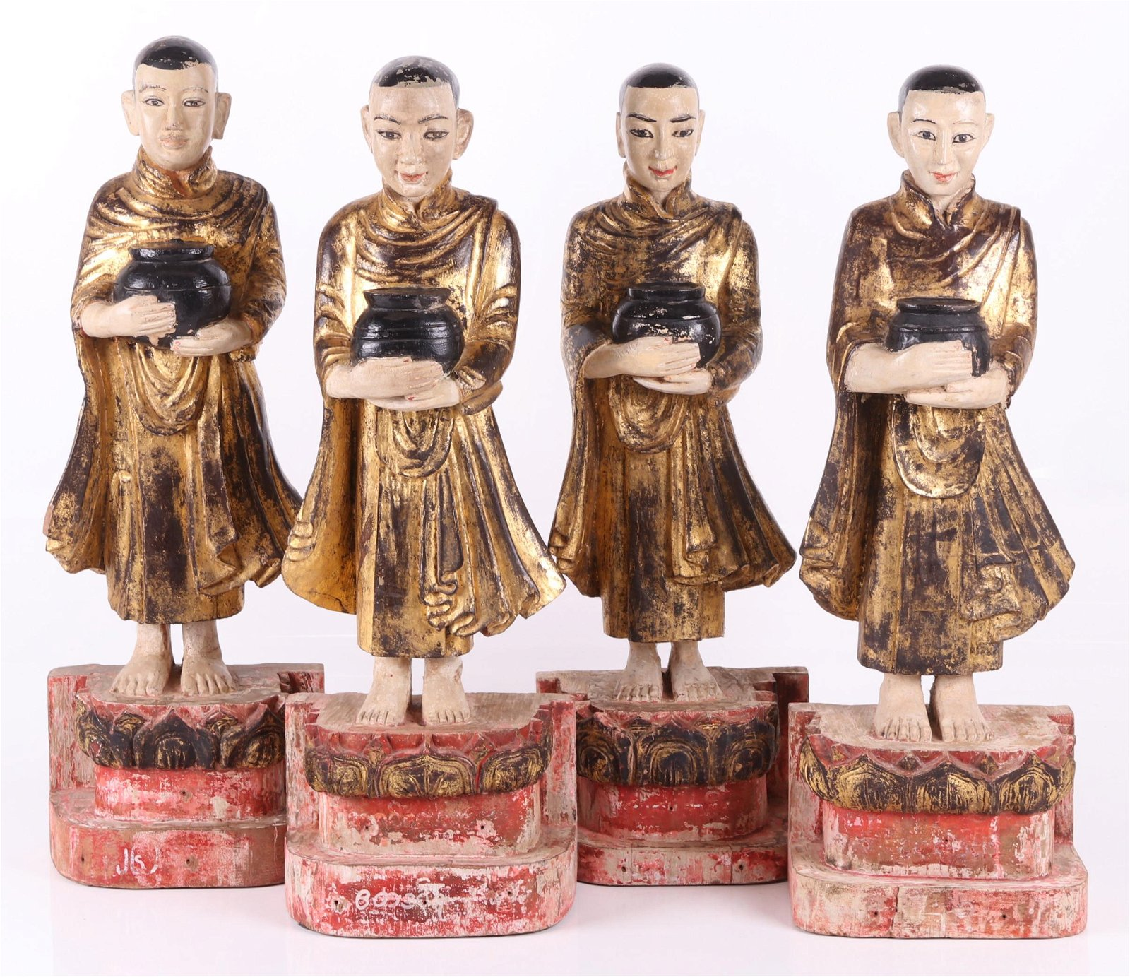 Four Southeast Asian Carved Wooden Monk Figures