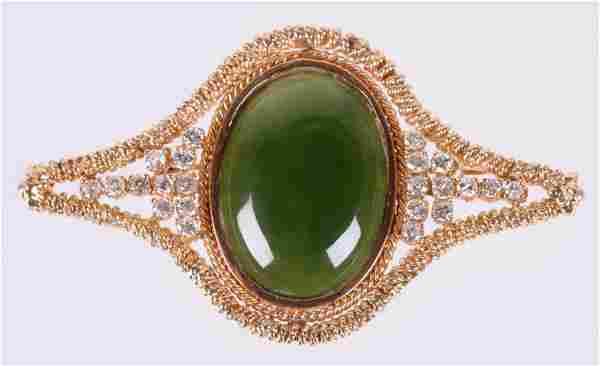 A Gold, Jade & Diamond Brooch
