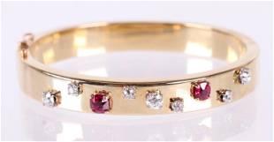 A Gold Bracelet Set with Gemstones