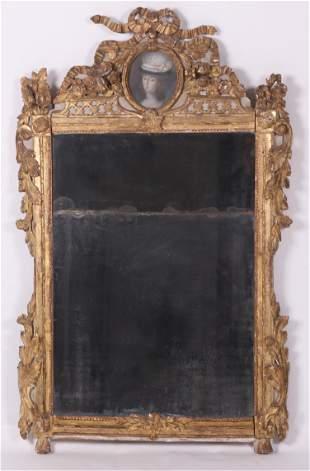 A Continental Gilt Mirror, 18th Century