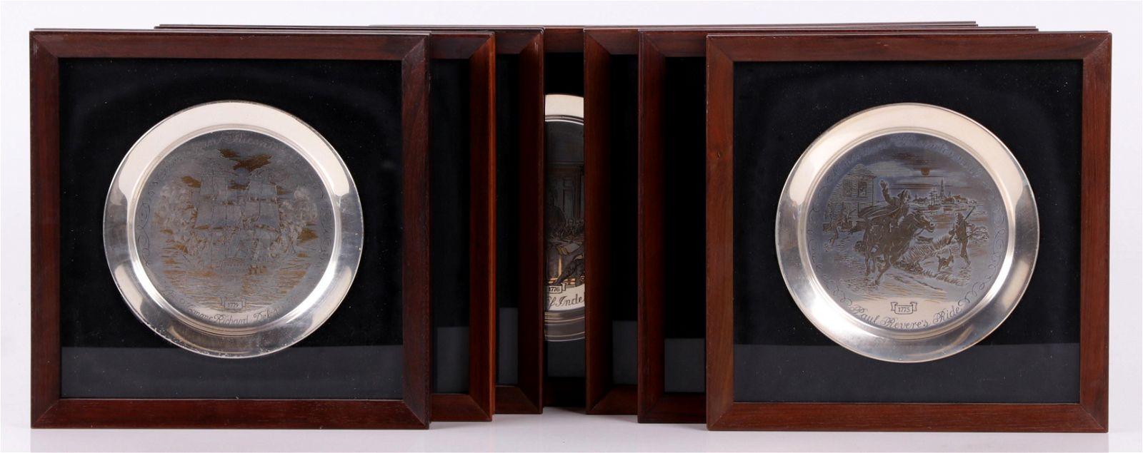 A Set of Seven Danbury Mint Sterling Plates