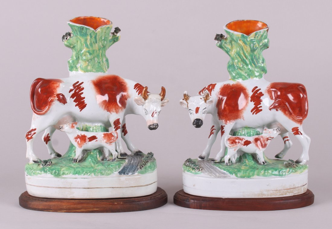 A Pair of Staffordshire Cow Spill Vases