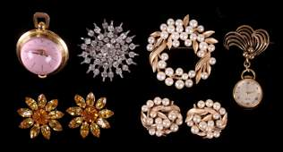 A Group of Costume Jewelry Including Watches