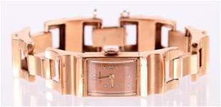 A Mid Century 14k Rose Gold Ladies Watch