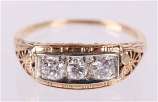 A Three Stone Diamond and 14k Gold Ring