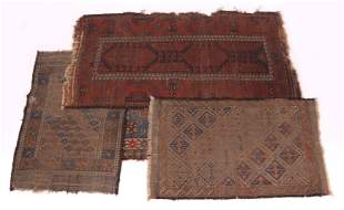 Four Antique Tribal Rugs