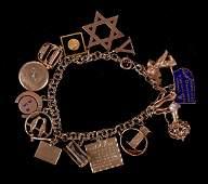 A 14k Gold Charm Bracelet