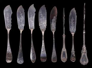 A Group of Silver Master Butter Knives