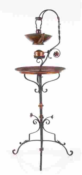 A Wrought Iron and Copper Teapot Stand