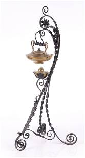 A Brass Teapot with Wrought Iron Stand