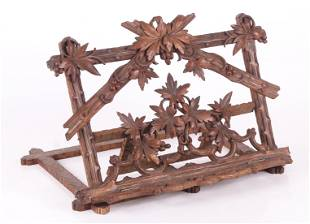 A Carved Folding Wooden Music Stand