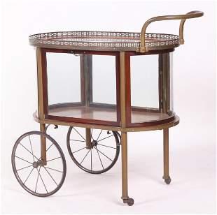 A Mahogany and Glass Tea Cart