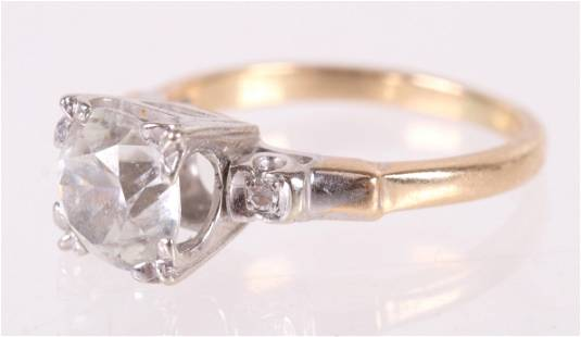 A 14k Gold and CZ Ring