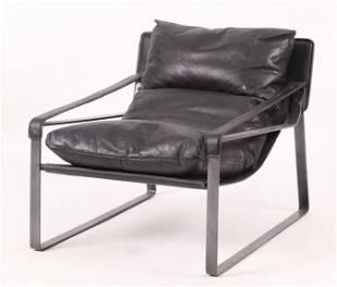 A Mid Century Modern Style Leather Armchair