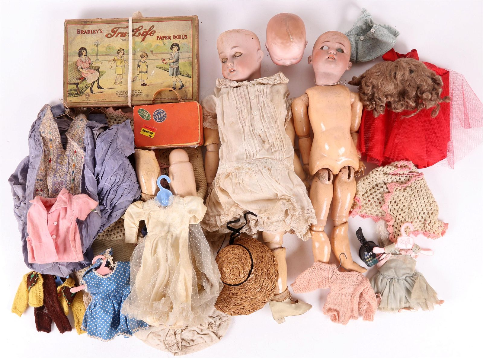 A Group of Antique Bisque Head Dolls
