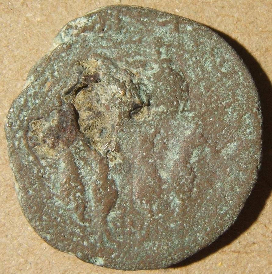 Roman coin possibly from Judea with figures on either