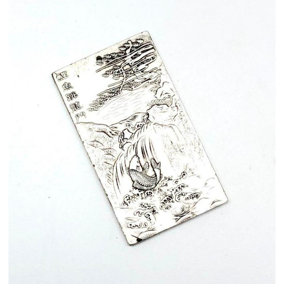 Asian Tibetan Silver Surfacing Koi Fish Swimming Up