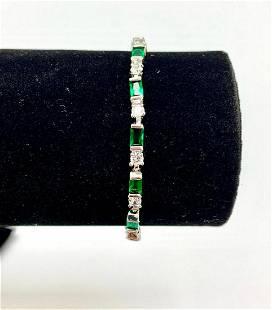 Ladies 1.35ct SYN Emerald Cut Emerald set in 14k Gold