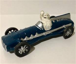 Vintage Cast Iron Toy Michelin Man Driving Race Car