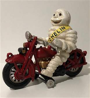 Vintage Cast Iron Toy Michelin Man on Harley Davidson