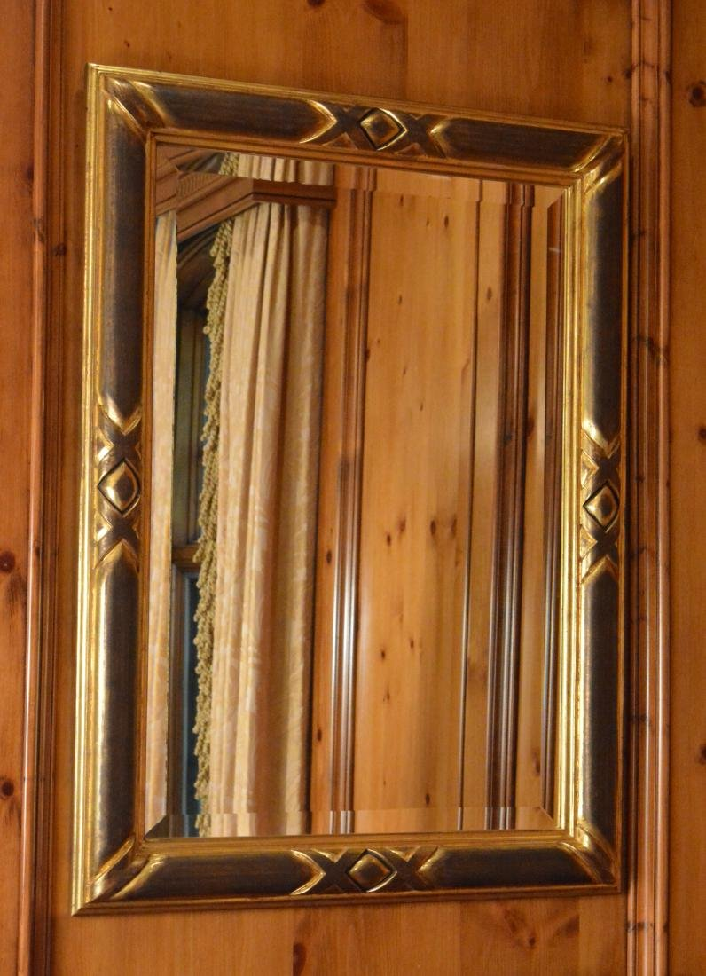 Pair of Ebonized and Giltwood Mirrors