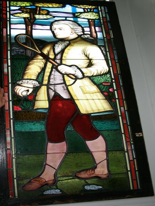 125: Stained Glass Image of Colonial Tennis Player