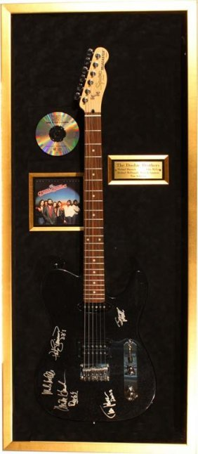 Electric Guitar Autographed By The Doobie Brothers