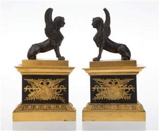 A Pair of Egyptian Revival Partial Gilt Bronze Chenets,