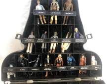 A group of vintage star wars figures in case with