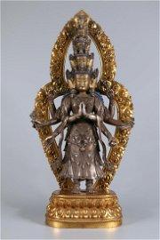A GILT SILVER BUDDHA STATUE