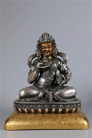 A GILT SILVER VAISRAVANA BUDDHA STATUE