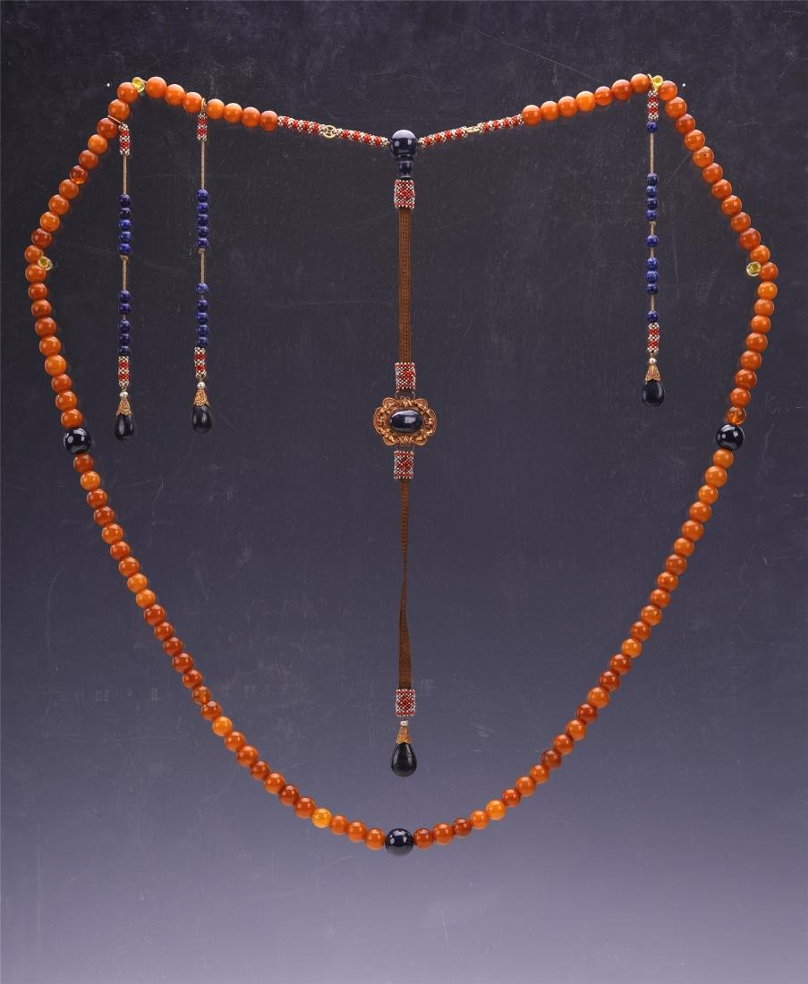 A Chinese Carved Amber Court Necklace