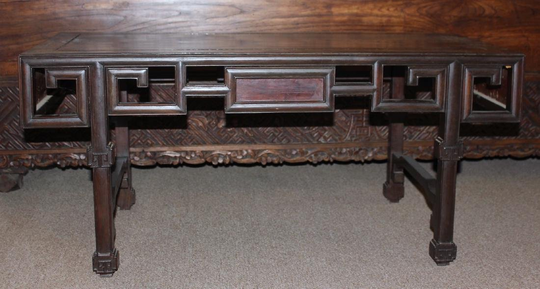 A Chinese Carved Rosewood Kang Table