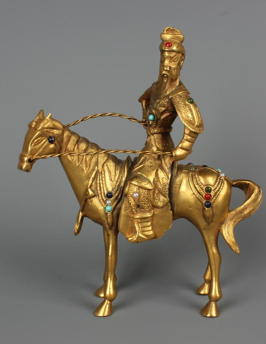 A Chinese Carved Gilt Bronze Statue