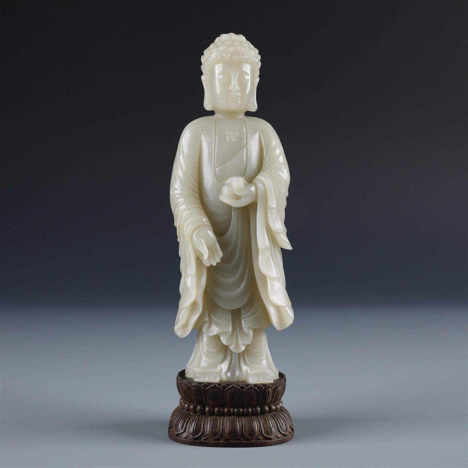 A Chinese Carved Celadon Jade  Figure of Sakyamuni