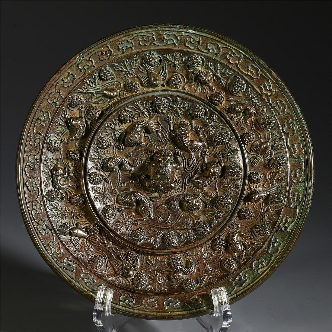 A Chinese Bronze Mirror with Beast Pattern