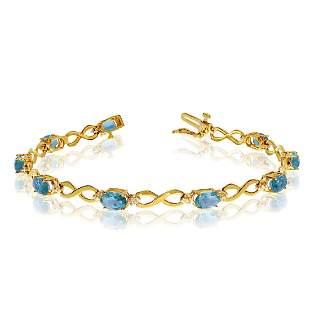 10K Yellow Gold Oval Blue Topaz and Diamond Bracelet 3.