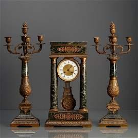 "GARNITURE - CLOCK ""PÓRTICO"" AND PAIR OF"