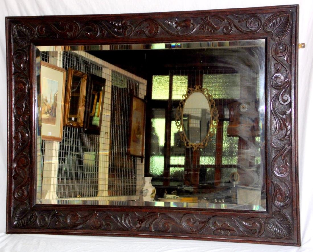 A Victorian Carved Oak Framed Rectangular  Wall Mirror.