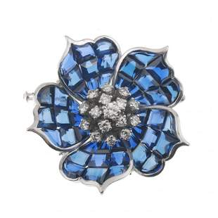 FLOWER-SHAPED BROOCH WITH SAPPHIRES AND DIAMONDS.