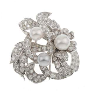 DIAMONDS AND PEARLS FLOWER BROOCH.