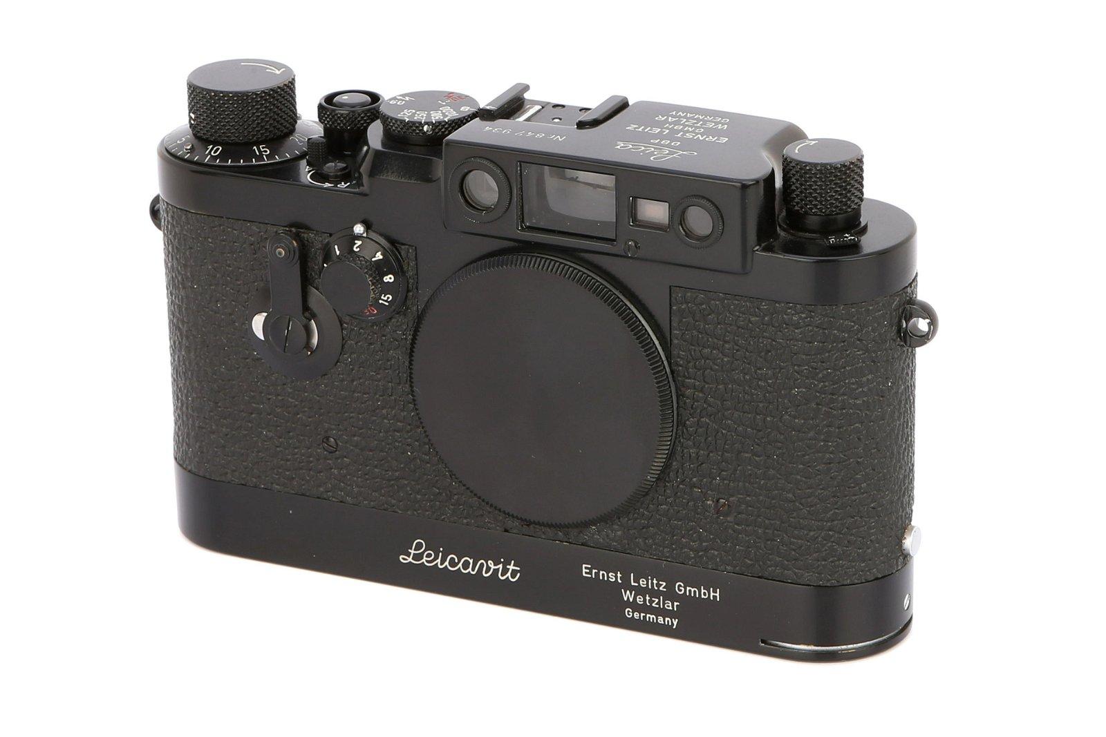 * A Leica IIIg Rangefinder Camera,