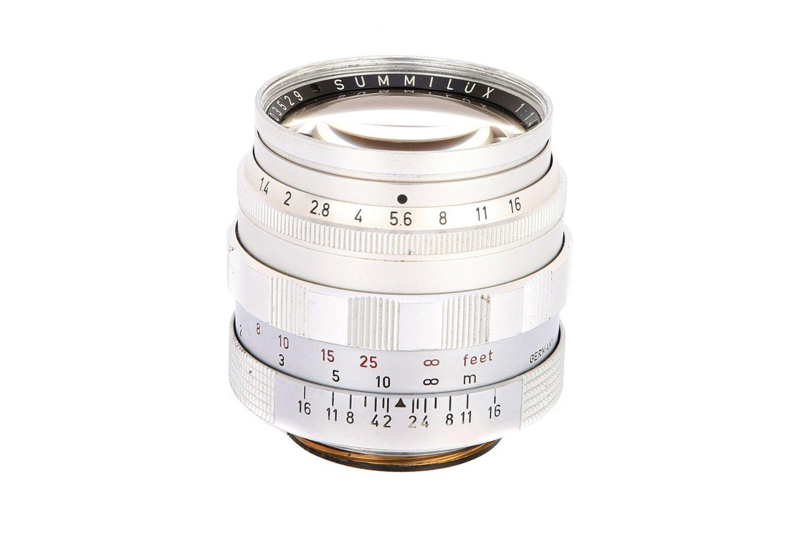 * A Leitz Summilux f/1.4 50mm Lens,