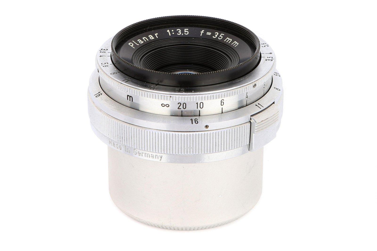 * A Carl Zeiss Planar f/3.5 35mm Lens,